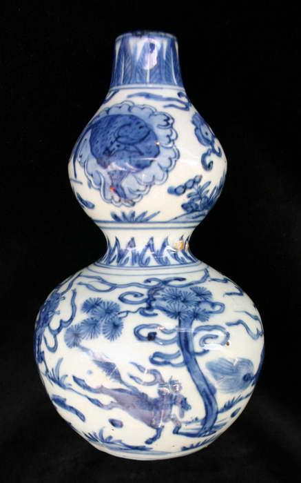 Ваза из лагенарии с эмалированной поверхностью и росписью гжель фото